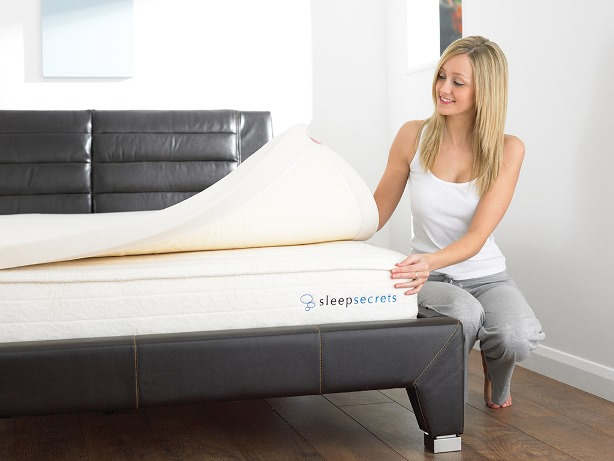 using topper to make mattress softer